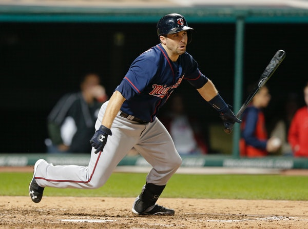 Minnesota Twins' Brian Dozier hits a single in the eighth inning of a baseball game against the Cleveland Indians, Thursday, Oct. 1, 2015, in Clevelan