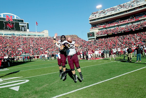 Gophers offensive lineman Tommy Olson (58) and Zac Epping celebrated the Gophers' 28-24 victory at Nebraska last November.