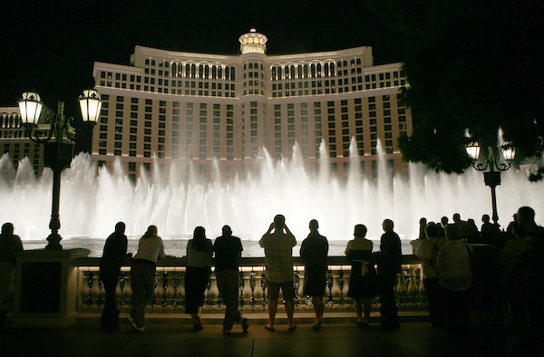 Tourists line up in front of the Bellagio in Las Vegas to watch the water show.