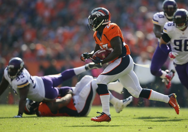 Bronco's Ronnie Hillman goes 72 yards for a touchdown in the first quarter on Sunday against the Vikings.