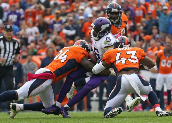 Vikings quarterback Teddy Bridgewater was sacked by DeMarcus Ware and T.J. Ward in the first half, one of seven sacks by the Broncos.