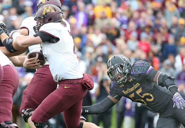Minnesota's quarterback Mitch Leidner carried the ball against the Northwestern Wildcats at Ryan Field, Saturday, October 3, 2015 in Evanston, IL.