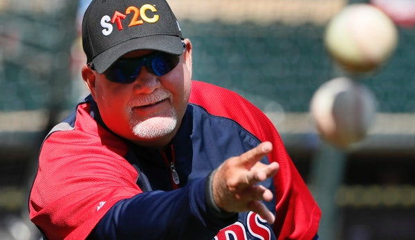 Twins manger Ron Gardenhire tossed balls during batting practice before theTwins home opener at Target Field against the Oakland A's Monday April 7, 2