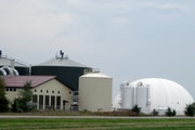 The Hometown BioEnergy plant in Le Sueur turns farm and food industry waste into methane to generate electricity.ity. Methane is stored in three white