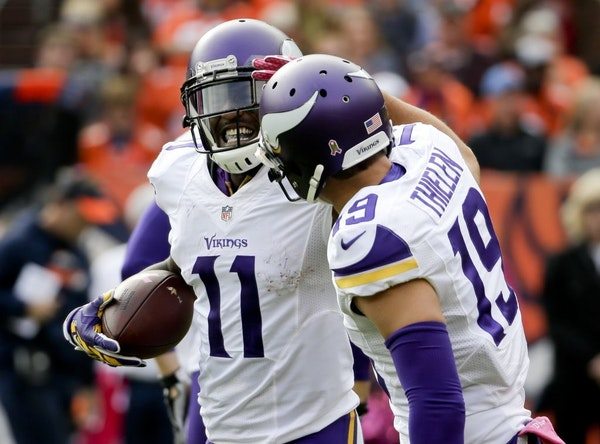 Vikings wide receiver Mike Wallace, left, celebrated after scoring with wide receiver Adam Thielen during the first half of Denver game on Oct. 4.