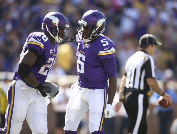 Vikings running back Adrian Peterson was congratulated on his first touchdown of the season by Vikings quarterback Teddy Bridgewater after his two yar