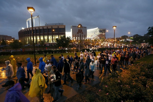 Fans evacuated the TCF Banks Stadium and headed to Mariucci and Williams Arenas in the second quarter after an announcement was made on the PA due to
