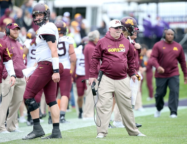 Minnesota's quarterback Mitch Leidner made his way back to the sideline after a fourth down as Jerry Kill exchanged words with a referee in the third