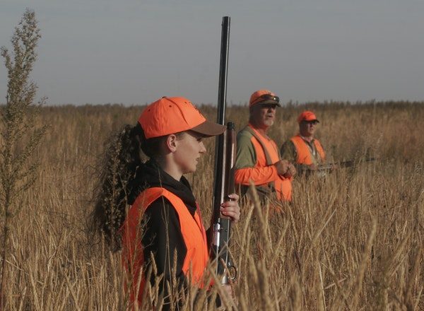 Julia Giefer, Scott Rall and Julia's dad, Brett, walked heavy cover looking for pheasants Saturday during the fifth Governor's Pheasant Hunting Op