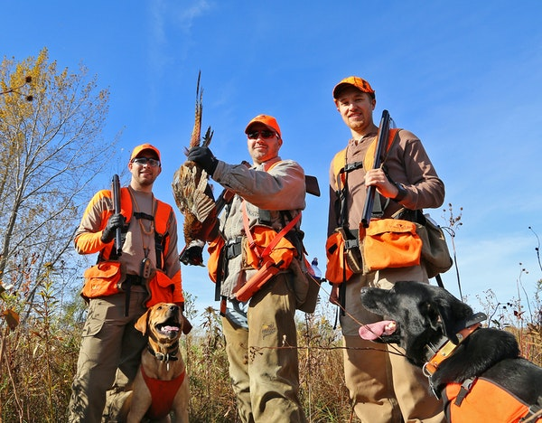 From left, happy hunters Logan Hinners, Andy Ness and Kale Hinners showed off a rooster pheasant taken in southeastern Minnesota on Saturday, opening