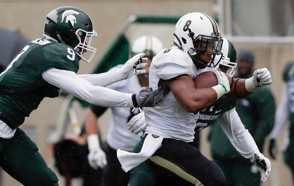 Purdue running back Markell Jones (8) pulled away from Michigan State safety Montae Nicholson (9) and cornerback Darian Hicks for a 68-yard touchdown
