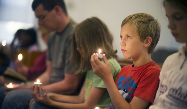 Joel Davis, 10, attended a vigil at Holsey Memorial CME Church with siblings Lydia, 11, Abigail, 13, and his father, Joel, to remember neighborhood fr