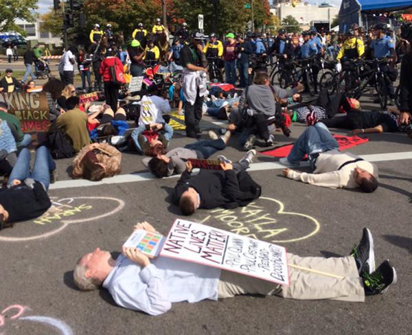 A die-in was part of the Black Lives Matter St. Paul protest at the 2015 Twin CIties Marathon.