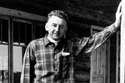 Emery Bulinski in 1967 on the porch of Snowbank Lodge. It was rebuilt from logs he had hauled across the ice.