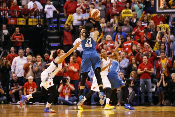 Lynx forward Maya Moore (23) makes the game-winning three point shot at the buzzer against Indiana in Game 3 of the WNBA Finals.