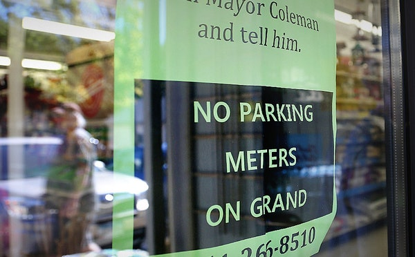 A customer walked into Frattelone Ace Hardware passed a sign that asked for support of no parking meters along Grand Ave. ] (KYNDELL HARKNESS/STAR TRI