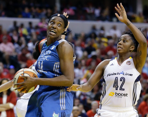 Lynx center Sylvia Fowles, left, headed to the basket as Indiana's Shenise Johnson defended in the second half of Game 4 of the WNBA Finals on Sunday.