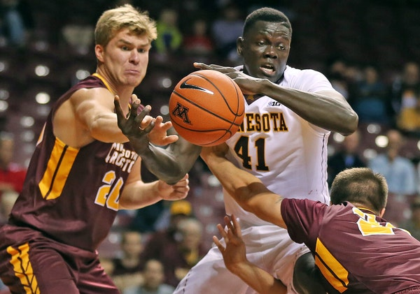 Gaston Diedhiou of Minnesota reached for a loose ball with Crookston's Darin Viken, left, and Riley Rice.