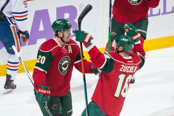 Minnesota Wild defenseman Ryan Suter (20) and left wing Jason Zucker (16) celebrated a goal by Suter in the first period against Edmonton.