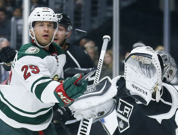 Wild right wing Jason Pominville, left, eyed the puck as he tries to score past Kings goalie Jonathan Quick.