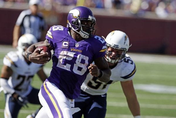Minnesota Vikings running back Adrian Peterson (28) heads to the end zone for a touchdown in front of San Diego Chargers outside linebacker Kyle Emanu