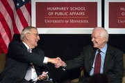 Walter Mondale, left, had a warm handshake for his former boss at the White House, Jimmy Carter, during a tribute Tuesday.