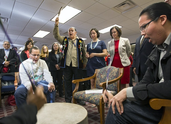 The Ringing Shield Drum circle sang before the Minneapolis City Council unanimously voted to recognize Indigenous People's Day. At left, Mary Delori