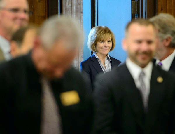 Lt. Gov. Tina Smith waited in the back of the room until she was introduced at the 2015 Minnesota Association of County Veterans Services Officers Fal