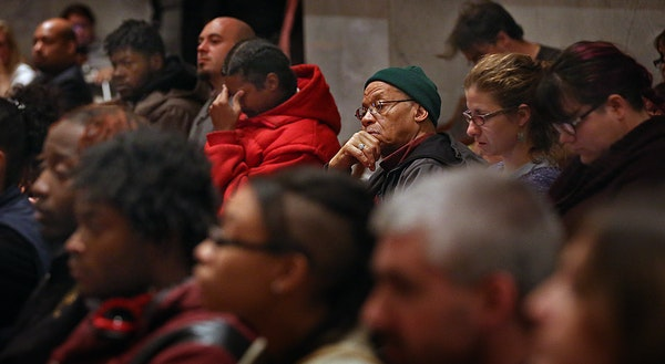 In October, a crowd listened as Minneapolis City Council members discussed a motion to return the Working Families ordinance to its author and to canc