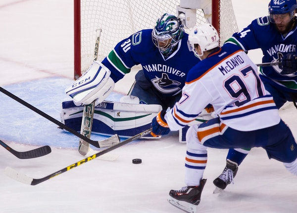 Canucks goaltender Ryan Miller made a save against the Oilers' Connor McDavid (97) in a Oct. 18 game.