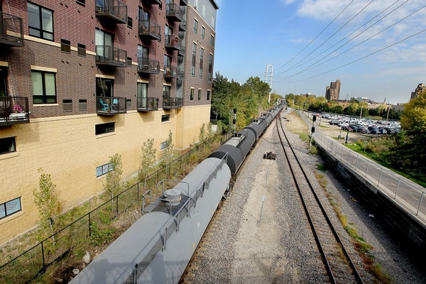 A train made its way along the tracks near downtown Minneapolis on Tuesday. The number of trains carrying oil from North Dakota and traveling through
