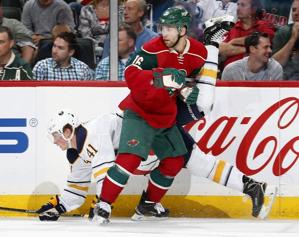Jack Eichel (41) of the Buffalo Sabres tangled up with Jason Zucker of the Wild.