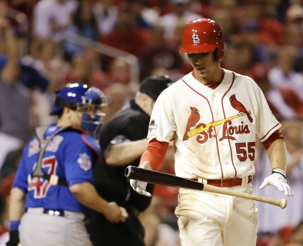 Cardinals rookie Stephen Piscotty reacted after striking out in the eighth inning against the Cubs on Saturday. Cubs righthander Trevor Cahill retired