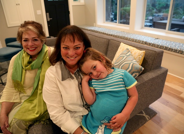 """Paula Ogg, left, with her daughter Katy McArron and granddaughter Betsy. Katy and Betsy live in the renovated lower-level """"condo"""", and Ogg lives u"""