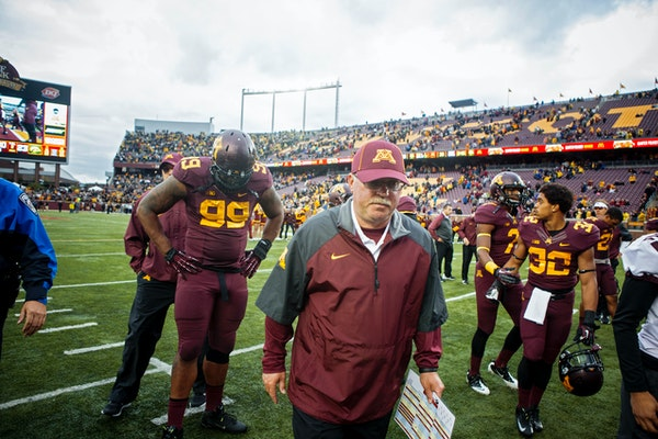 Jerry Kill, head coach for the University of Minnesota football team, walks off the field after a home game against the Iowa Hawkeyes in Minneapolis i