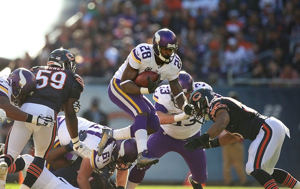 Vikings running back Adrian Peterson (28) with a second quarter gain Sunday afternoon.