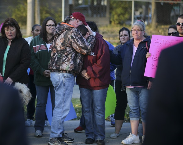 On Wednesday, Terry Zietlow hugged Julie Zietlow, who is the mother of Sarah Wierstad, who was killed in a shooting recently, during a peace march aft
