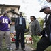 When tragedy strikes, Pastor Harding Smith often shows up in a football jersey. Here, he led a prayer at the house where three children died in a fire
