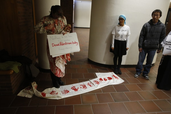 Protesters outside a lecture hall at the University of Minnesota Law School on Tuesday.