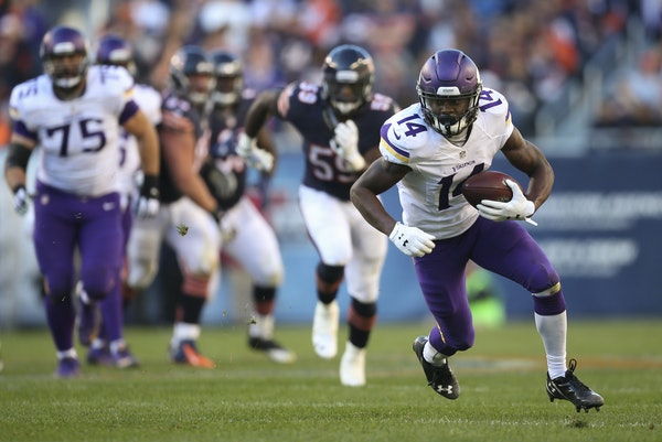 Vikings wide receiver Stefon Diggs (14) made a move on Bears cornerback Sherrick McManis (27) after catching the football and went all the way to the