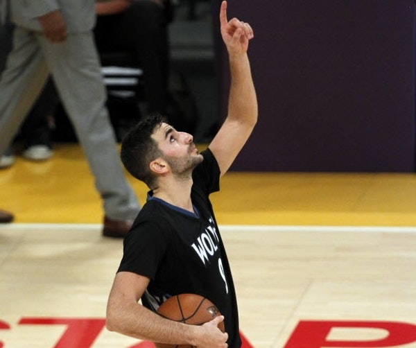 Wolves guard Ricky Rubio, who scored a career high 28 points, pointed skyward in honor of Flip Saunders after the final horn of Wednesday's season ope