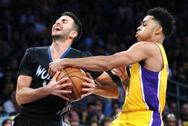The Los Angeles Lakers' D'Angelo Russell, right, fouls the Minnesota Timberwolves' Ricky Rubio in the first quarter at Staples Center in Los Angeles o