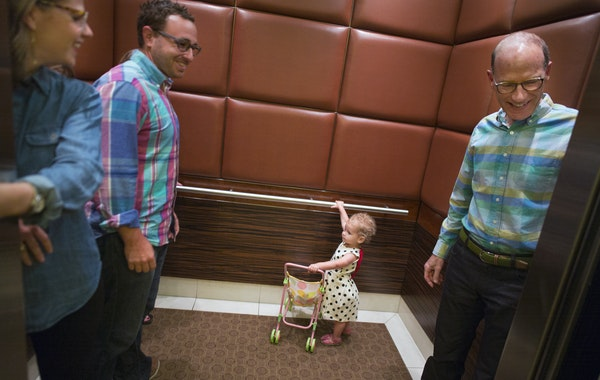 Top photo, Betsy Kuller and husband Ben Gerber boarded an elevator with daughter Rozlyn, 2, and Kuller's father, Hart, at the Carlyle in downtown Mi