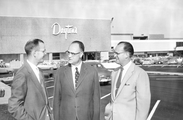 Bruce Dayton, left, talked with Prudential executives outside Southdale Mall in 1956. Dayton's was the key anchor tenant when the first enclosed mall