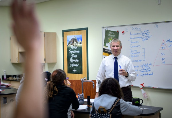 Greg Moen teaches a spirited seventh-grade life sciences class at TrekNorth. The poster in the background hangs in every classroom, the Trek Traits of