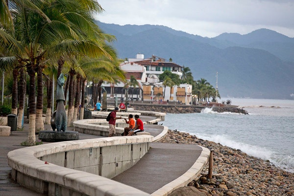 People enjoyed a seafront walkway the morning after Hurricane Patricia passed further south, sparing Puerto Vallarta, Mexico, Saturday, Oct. 24, 2015.