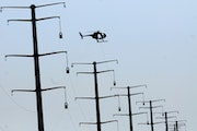 Xcel Energy said it will begin seeking a three-year rate hike of nearly 10 percent from Minnesota customers. File photo of new Xcel power lines under