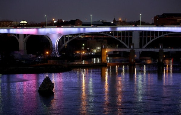 The I-35W bridge lit up in French national colors in support of Paris and the people of France.