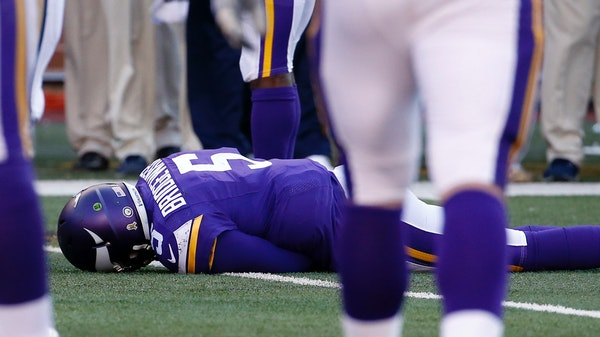 FILE - In this Nov. 8, 2015, file photo, Minnesota Vikings quarterback Teddy Bridgewater lies on the field after a hit during the second half of an NF