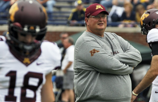 Tracy Claeys during his first stint filling in for Jerry Kill in 2013.